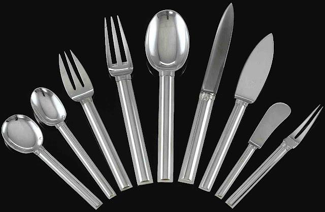 a 1928 Jean E. Puiforcat dining silverwear design in a radiating arrangement