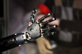 A modern brain-controlled prosthetic hand and arm co-developed by the Applied Physics Laboratory and the Federal Drug Administration.