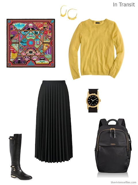 Classic travel outfit in black and yellow, with an Hermes scarf