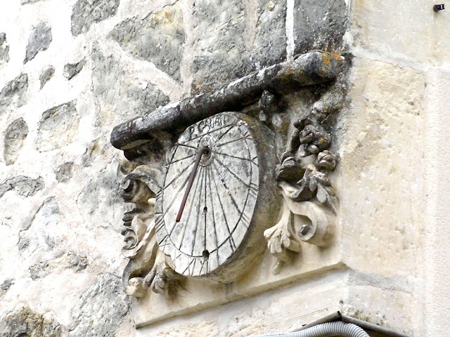 17C sundial on a village house.  Indre et Loire, France. Photographed by Susan Walter. Tour the Loire Valley with a classic car and a private guide.