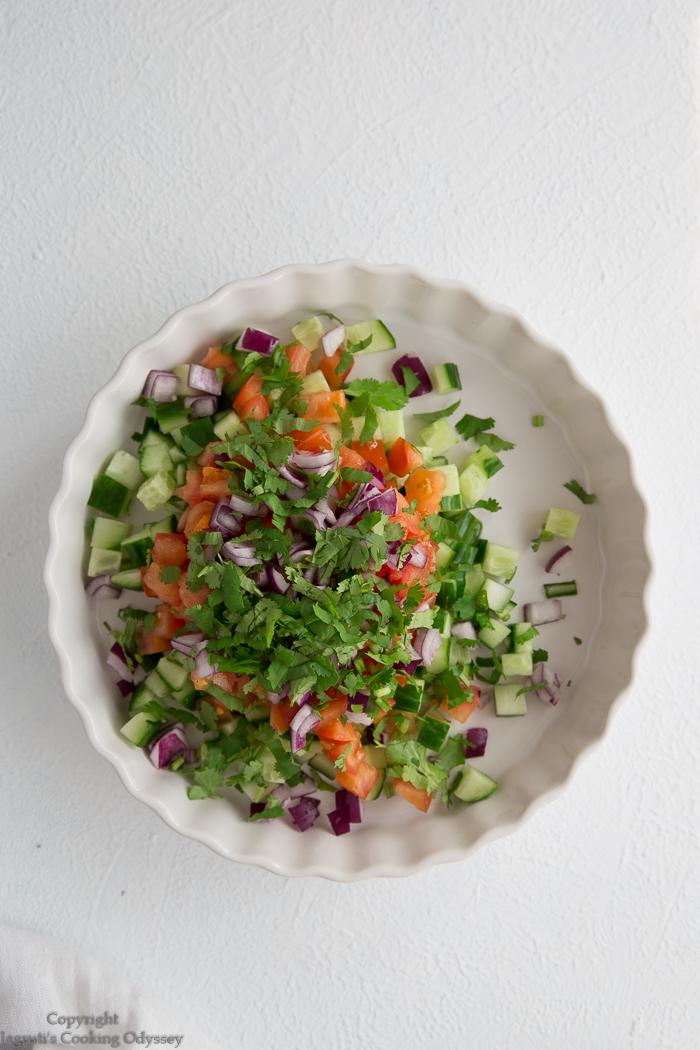 Making kachumber salad step 4 freshly chopped cilantro