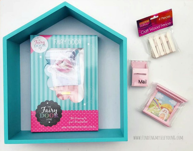 fairy door and fairy accessories to create a shadow box fairy house