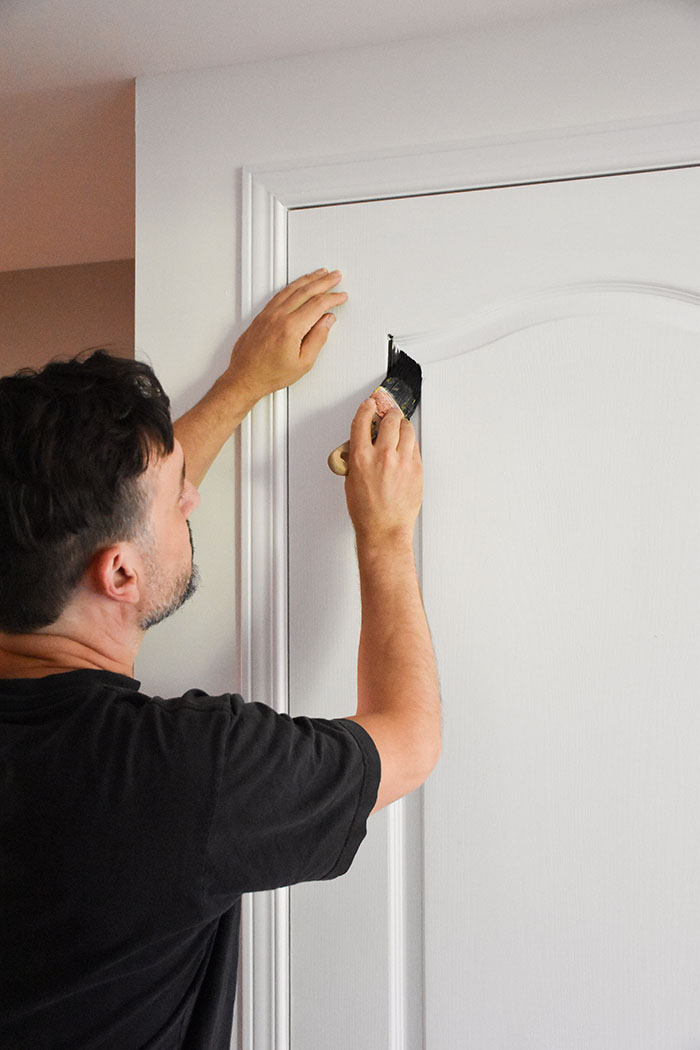 cutting-in-with-fusion-mineral-paint-in-coal-black-on-interior-door
