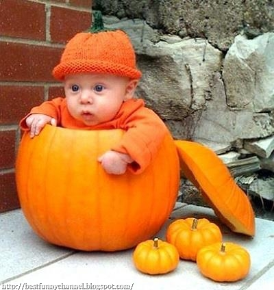 Funny baby in a pumpkin.
