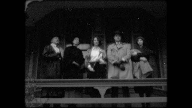 A black-and-white photo of a group of people