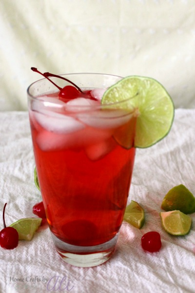 refreshing and delicious fizzy mocktail with cherry and lime