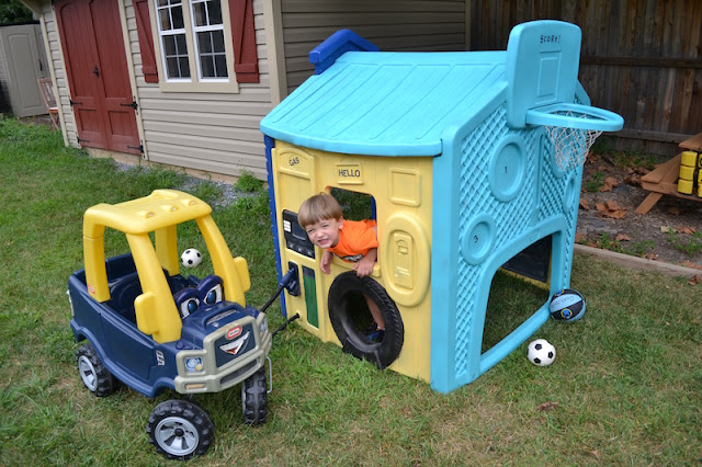 Gas station area of a plastic playhouse.