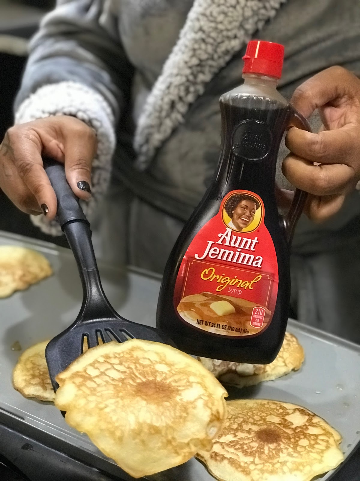 Image: Tangie Bell cooking more pancakes and using aunt jemima syrup. Not sponsored