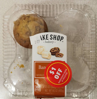 A package of Bake Shop by Aldi Banana Nut Muffins, with all but one muffin missing