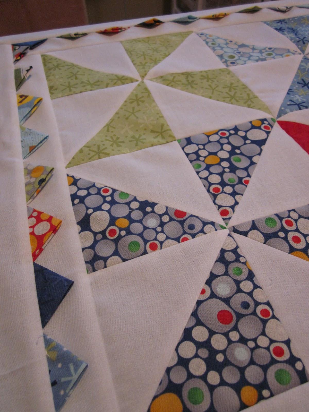 Not present. Moda three strip pinwheel quilt pattern
