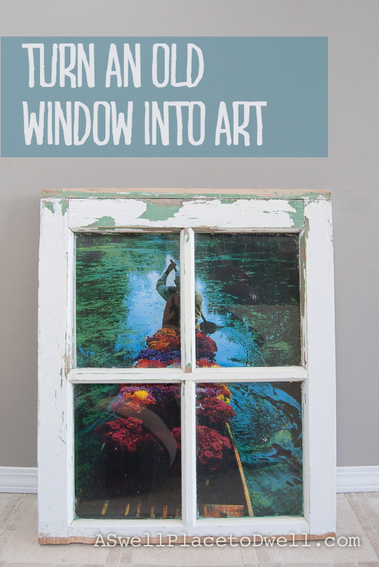Turn an antique window into art using an old poster.  www.aswellplacetodwell.com