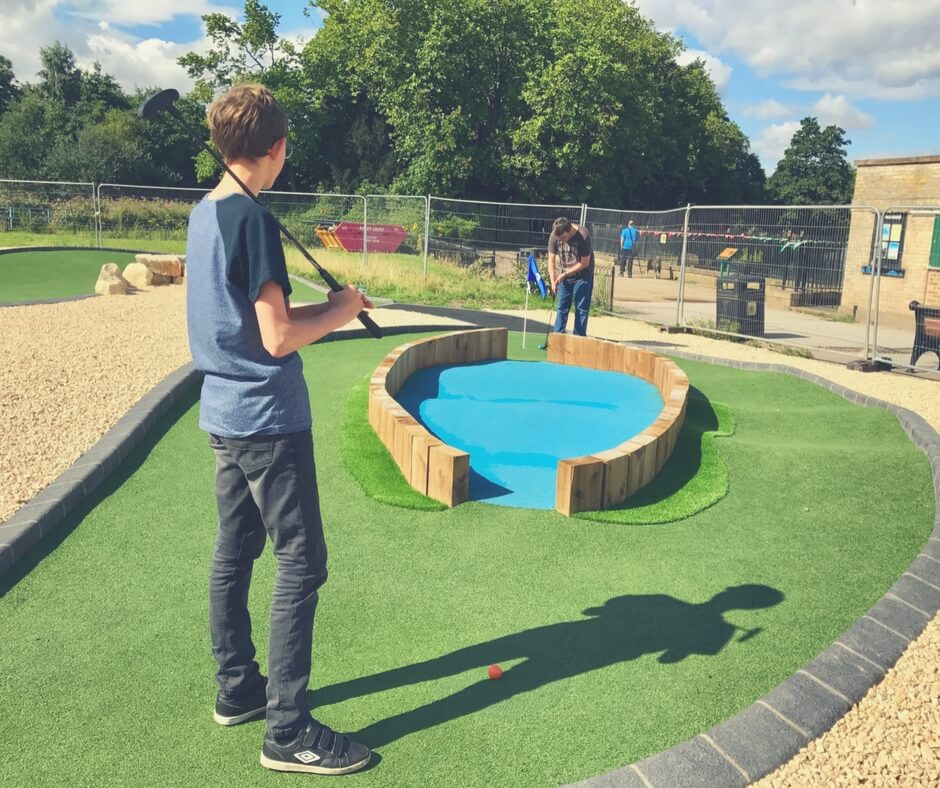 boy plays adventure golf