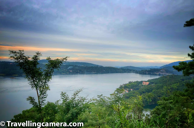 Umiam Lake is a beautiful place to take a stop while you are traveling from Guwahati to Shillong, but it's not just a lunch break spot but a popular tourist place where lot of tourists in this area come and enjoy water-sports apart from day-time picnic activities around lake-side. This blogpost shares more about Umiam Lake and some facts which can help planning your trip better in this part of Meghalaya state in India.     Related Blogpost from Meghalaya - One Day Trip to Mawlynnong Living Root Bridge & Dauki River from Shillong, Meghayala    Umiam lake was built by the Assam State Electricity Board in the early 1960s and it was created because of the dam created on Umiam river. The dam's original purpose was to store water for hydroelectric power generation unit.    Related Blogpost from Meghalaya - One Day Trip from Shillong to Cherrapunji, Meghalaya    The Umiam lake serves as a major tourist attraction for the state of Meghalaya. It is also a popular destination for water sport and adventure facilities. Tourists visit this spot for kayaking, water cycling, scooting and boating.    Related Blogpost from Meghalaya - Mawsmai Caves - A great place to explore in Cherrapunji, Meghalaya (India)    While you are driving on the road from Guwahati to Shillong, the lake comes on your right and visible for quite a long stretch. There are even places where vehicles stop for tea/maggie breaks from where Umiam lake can be seen. The only photograph used in this blogpost is clicked from one of the break points around the road overlooking Umiam Lake in Meghalaya.     Related Blogpost from Meghalaya - Mawlynnong - Meghalayan Village known for it's cleanness & Living Root Bridge    Apart from storing water in Umiam Lake for electricity generation, Umiam Lake also provides numerous ecosystem services at micro as well as macro levels. Downstream irrigation, fisheries and drinking water cater to local needs & create plenty of opportunities for people living around the lake.    Related blogpost from Meghalaya - Seven Sisters Waterfall, Cherrapunji || Nohsngithiang Falls of Meghalaya    Umiam lake is in outskirts of Shillong and can be visited as a part of Shillong sight seeing or while travelling to or from Guwahati. Boating is available at Umiam Lake. Two types of boats take either 5 or 10 people. One has to wait till gathering of required number of people to buy boating tickets. The place is maintained very cleanly.     Related Blogpost from Meghalaya - Unusual boating experience at Dawki River, at Bangladesh border in Meghalaya (India)
