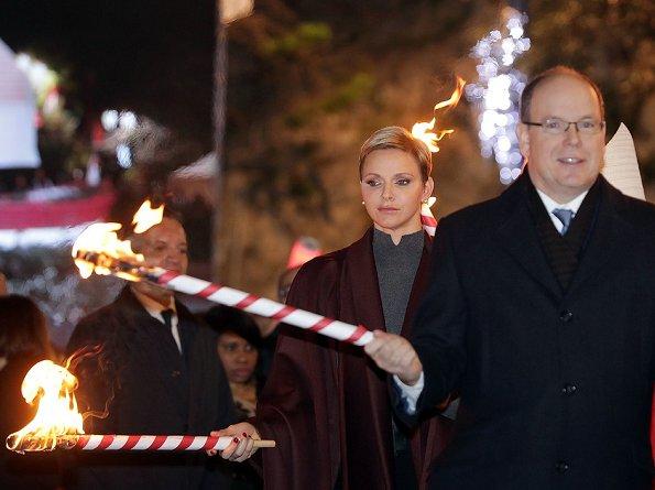 Princess Charlene and Prince Albert attend the traditional 2017 Sainte Devote procession in Monaco. Wore Akris cape
