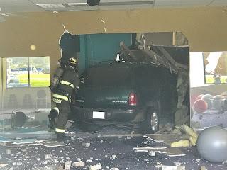 car crashed inside a building