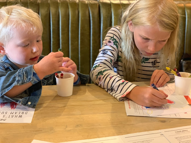 Children colouring in dream sundae competition forms at Bill's Restaurant