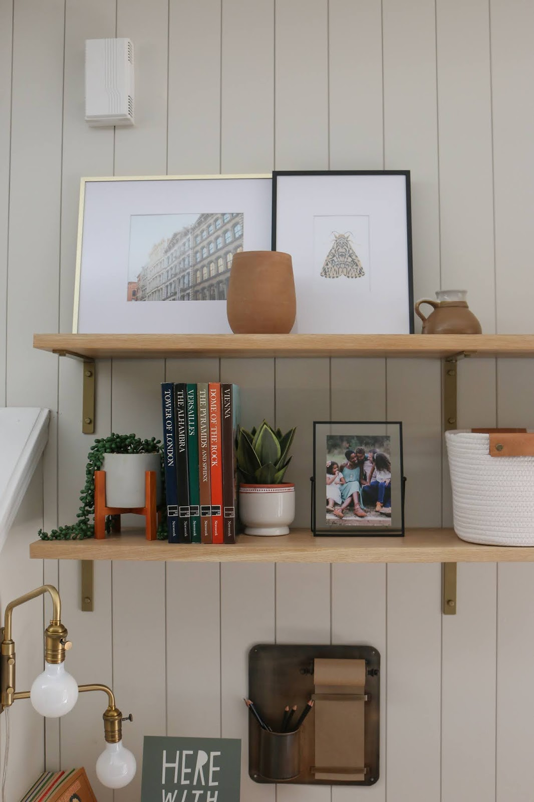 DIY office nook with wall to wall shelves, a built in desk, and vertical shiplap