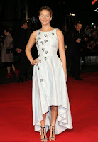 We're confused, cause we though Jennifer Lawrence was playing the famous nun turned governess in a TV version of the Sound of Music. And yet this dress suggests she's playing the famous princess from Cinderella as the actress raised the fashion stakes at the Hunger Games premiere in London on Monday, November 10, 2014.