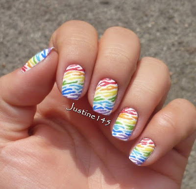 http://justine145.blogspot.com/2014/09/31dc2014-day-09-rainbow-nails.html