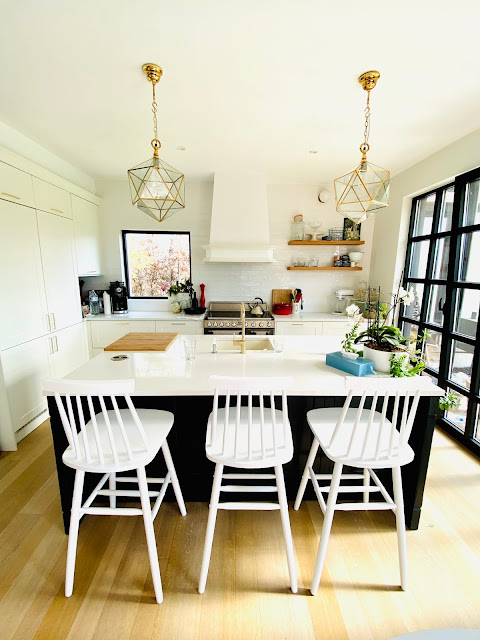 open kitchen with gold blue and white
