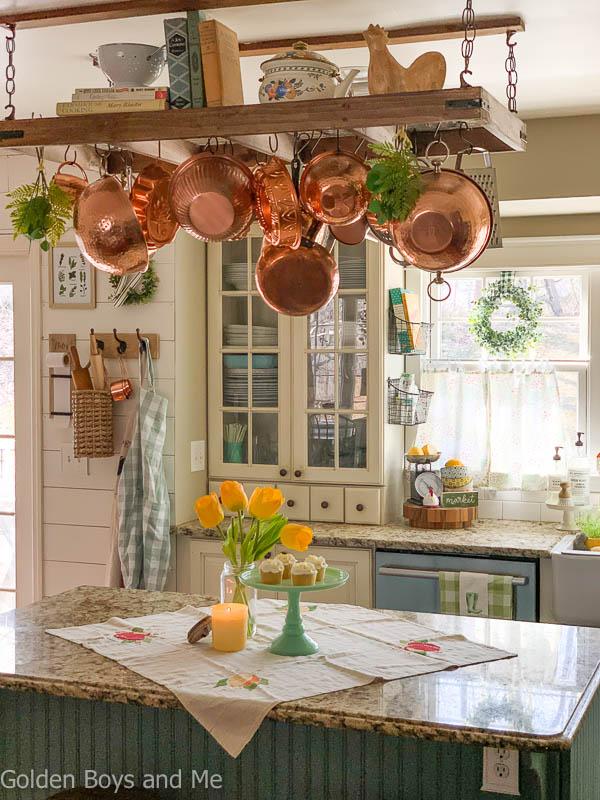 Farmhouse style kitchen with diy pot rack andspring decor - www.goldenboysandme.com