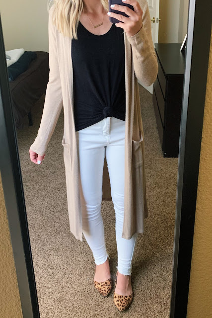 White jeans with a tan duster cardigan