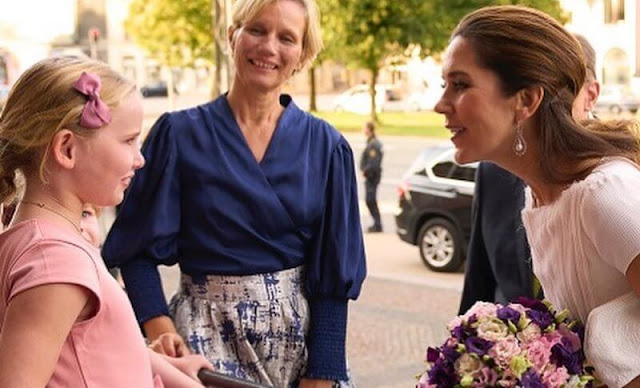 Crown Princess Mary wore a white dress by David Andersen, and snowdrop earrings by Dulong Fine Jewelry