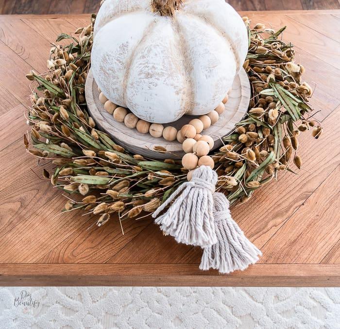 pumpkin centerpiece on herringbone coffee table