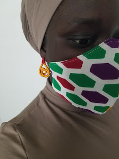 How Ankara facemask complements formal dressing
