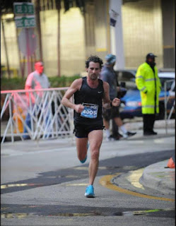 Dino LaCapra running in a marathon road race