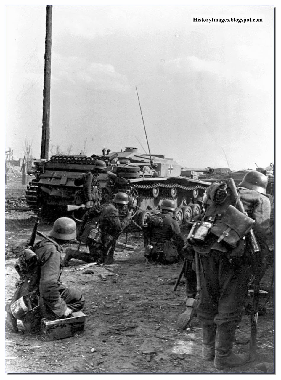 German soldiers crouch behind  Stug 3 assault gun outskirts of Stalingrad 1942 Rare WW2 Image