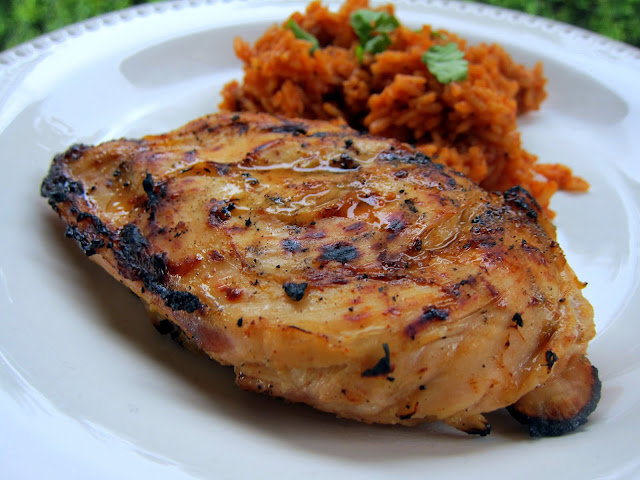 Spicy Margarita Chicken Recipe - tequila, trip sec, lime juice, chili powder, garlic, cumin and a fresh jalapeño - tastes like a margarita with a kick! Great with some quick Mexican rice or as fajitas.