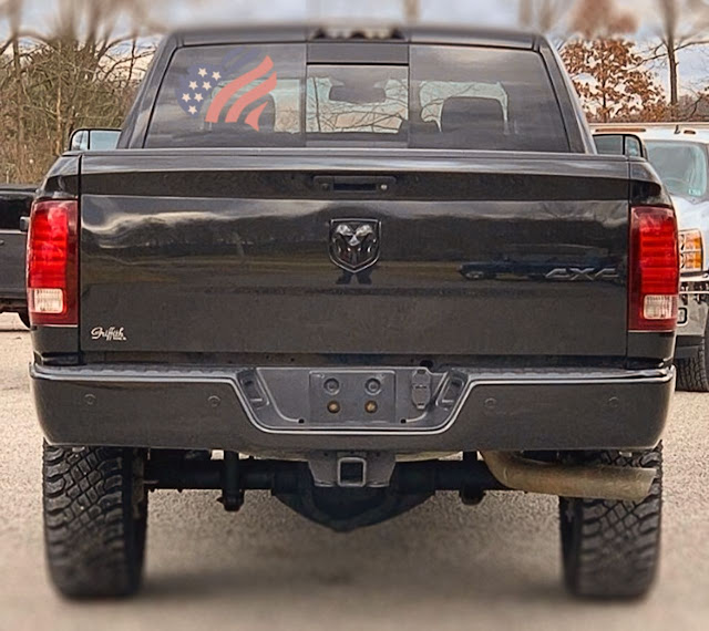 Colorful-heart-shape-American-flag-window-decal-sticker-on-black-ram-1500