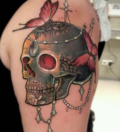 kelebekli kuru kafa dövmesi skull tattoo with butterflies