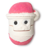 Two white spherical bath bombs, one plain white, one with two white eyes with circular black dots and a red hat on a bright background