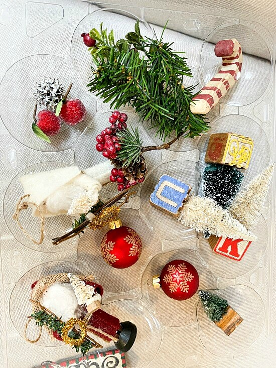 Recycled apple packaged filled with Christmas ornaments