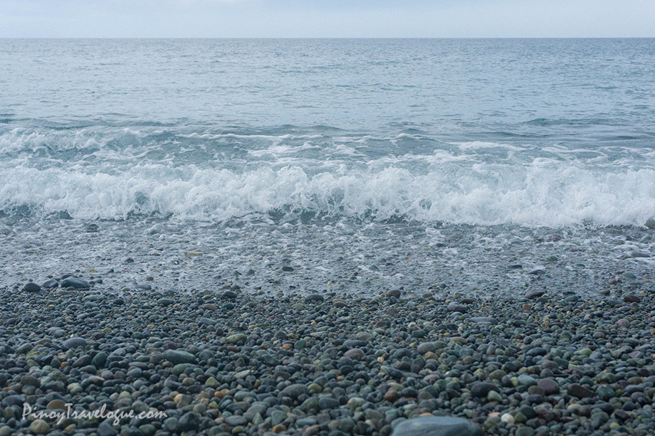 Waves crashing against the pebbles
