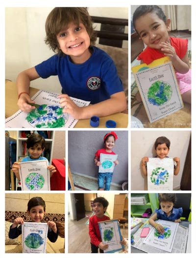 Children display poster during Earth Day Celebrations