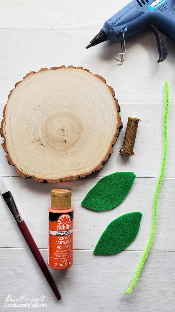 Supplies Needed for Wood Slice Pumpkin: Wood Slice Orange Craft Paint Tree Branch  Paintbrush Green Felt Green Pipe Cleaner Hot Glue/Gun Scissors