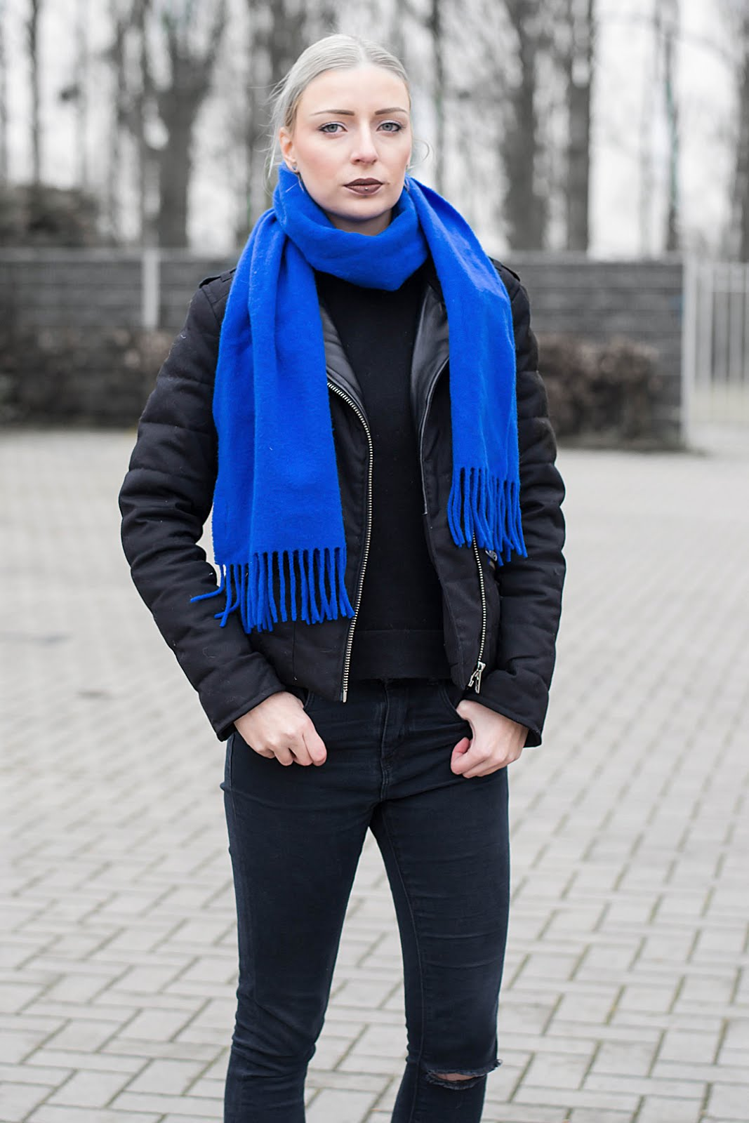 Black outfit, cobalt blue accessoiries and the kooples jacket