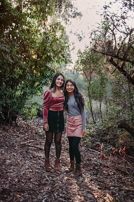 Teenage sisters posing for portrait for Christmas mini sessions with Morning Owl Fine Art Photography located in San Diego.