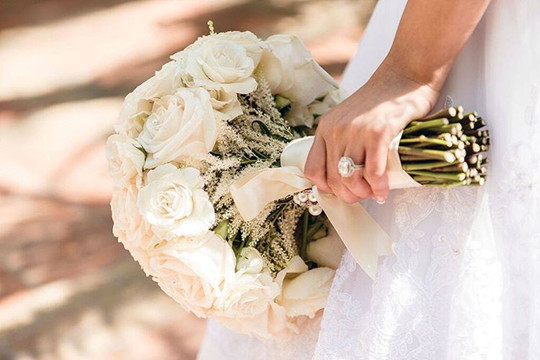 Traditional outdoor wedding white roses bridal bouquet