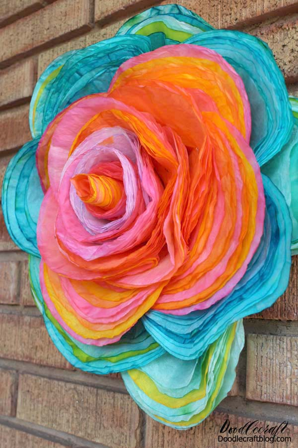 115 brightly colored layered coffee filters to make a giant 16 inch rose!