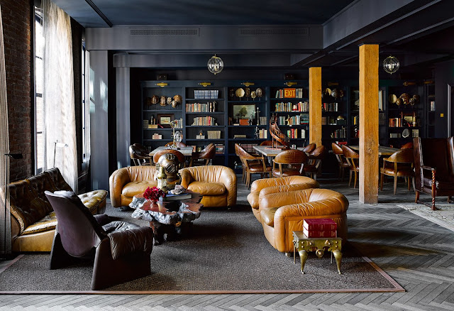 Gorgeous library with black walls and modern leather chairs in San Francisco by Ken Fulk
