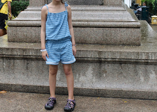 Striped chambray girls' romper with lace trim made from the Purl Soho Summer Romper sewing pattern.