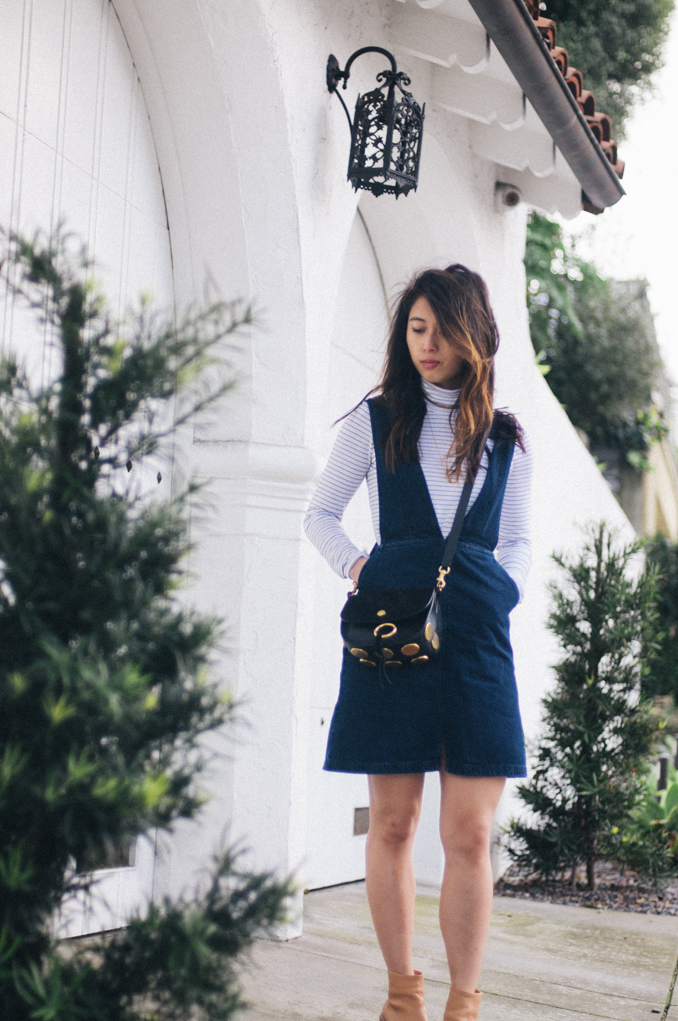 san francisco bay area fashion blogger wearing denim overall dress striped turtleneck shopsoko necklace and chloe kurtis shoulder bag