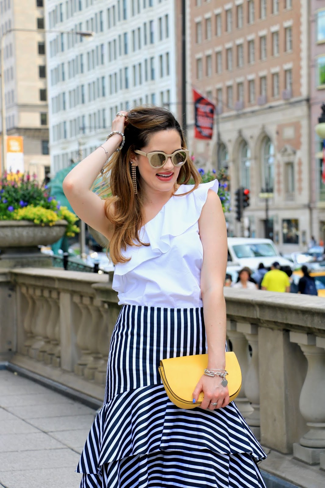 Nyc fashion blogger Kathleen Harper wearing an off-the-shoulder ruffle top
