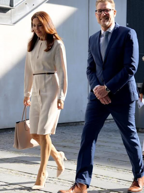 Crown Princess Mary wore a natural Lynne pleated silk dress from Joseph, Gianvito Rossi beige pumps, Dulong Delphis gold earrings