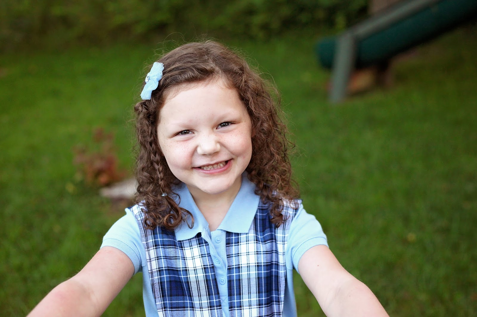 kindergarten girl side ... side of Kindergarten, and I am struck by how insanely fast it went and  how much my child has grown since August...physically, emotionally,  academically, ...