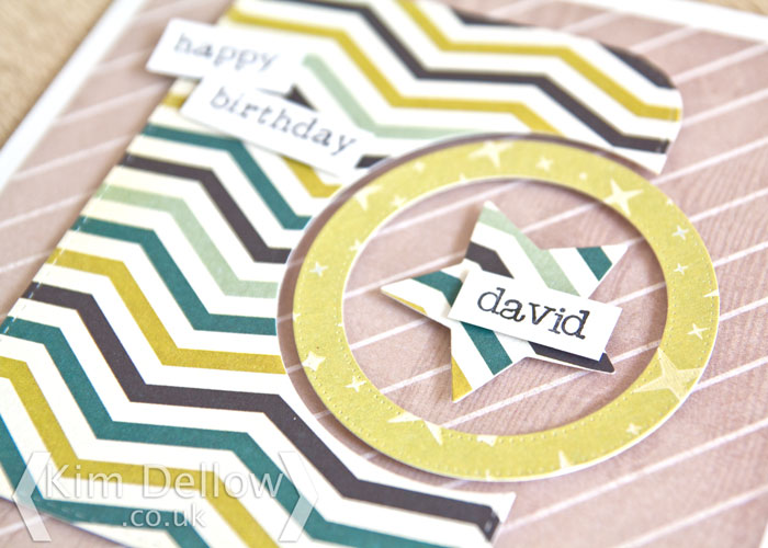 close up of a Superhero inspired die-cut card by Kim Dellow